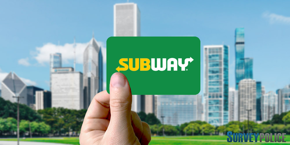 Holding subway gift card against cityscape